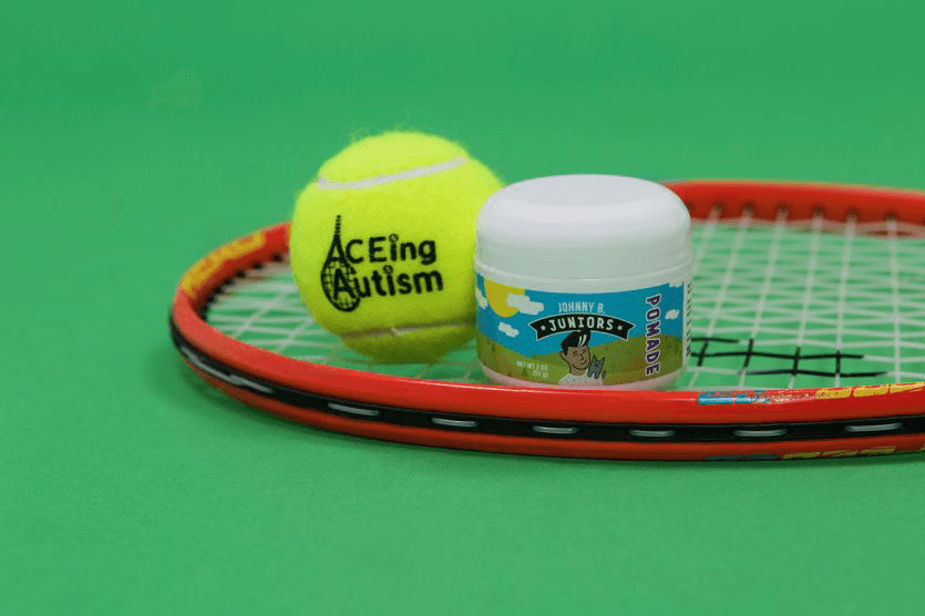 hero image of pomade, racquet, tennis ball